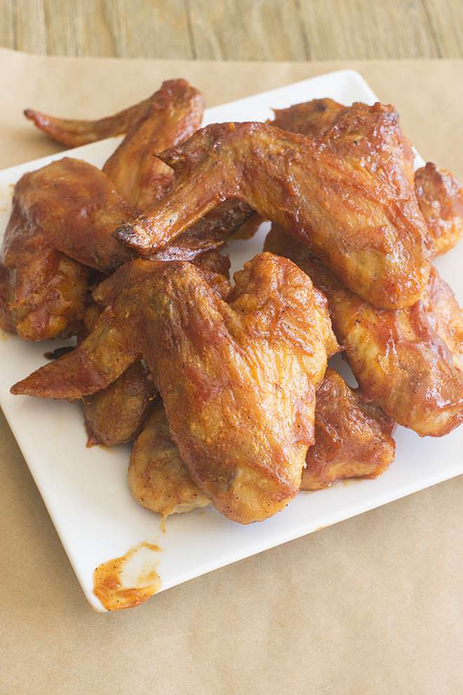 Here's where two of my best ever recipes meet to become the best ever BBQ chicken wings. Crispy oven-baked wings with deliciously perfect sweet BBQ sauce.