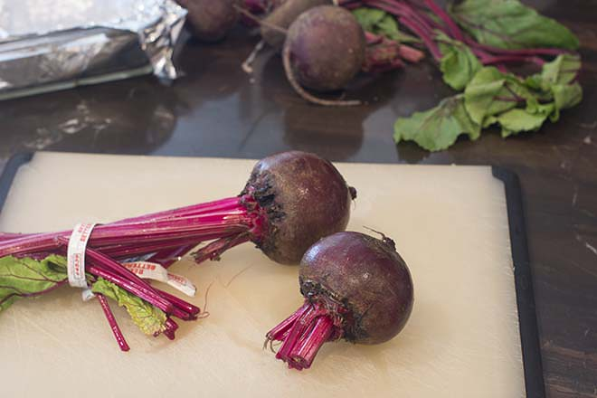 Trim stems from beets.