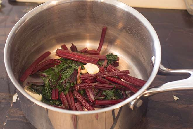 Add butter to the beet greens.