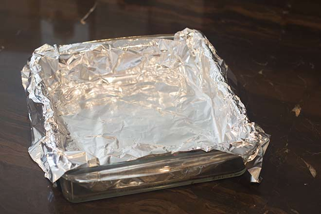 Line a baking dish with foil.