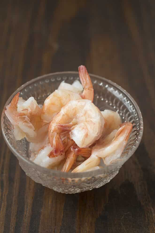 The BEST way to cook shrimp is to poach them gently. They end up delicate and so juicy. Learn how here.