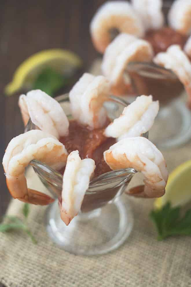 Learn how to make a perfect shrimp cocktail at home, including your own homemade cocktail sauce and instructions for the type of shrimp to use and how to cook them so that they're tender, juicy and delicious.