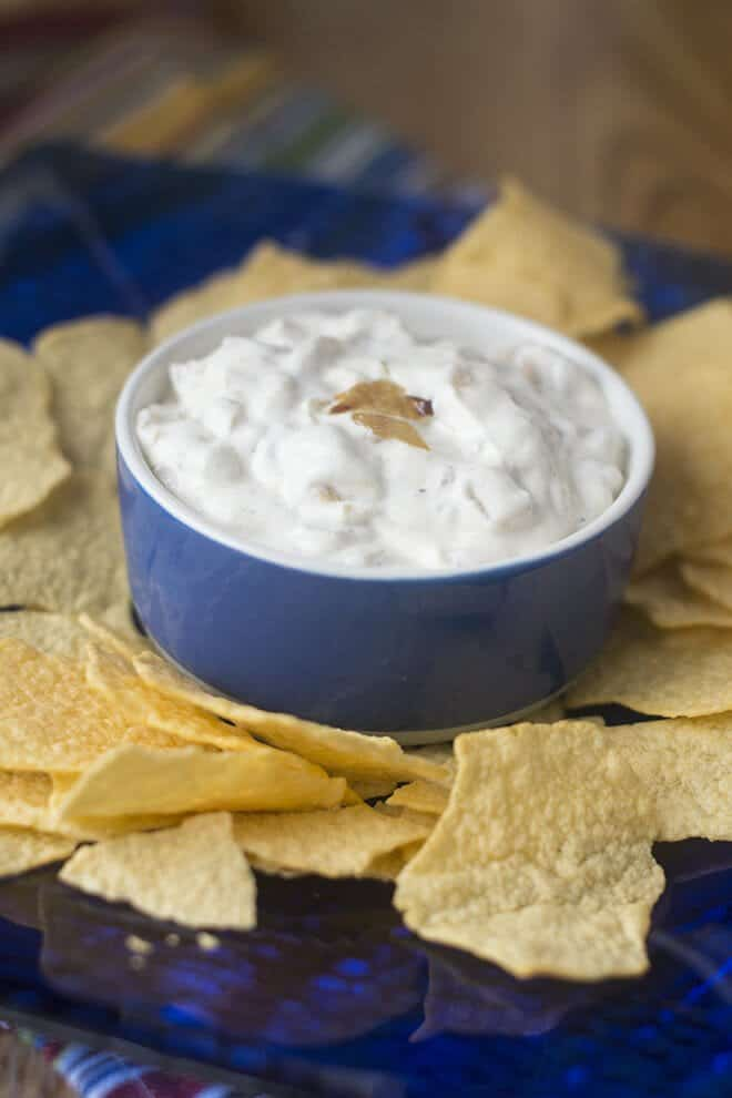 Chip dip recipes are a staple for parties and game day. This old time favorite French Onion Dip is made from scratch (no packet of dried onions here!) but it tastes just like the original. Dip in!