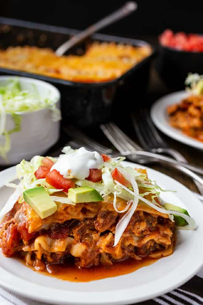 Mexican-inspired flavors layered in between lasagna noodles? Yes, I call it Taco lasagna.