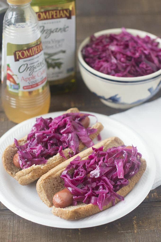 Our quick homemade red cabbage sauerkraut gives grilled hot dogs a beautiful grown up twist.