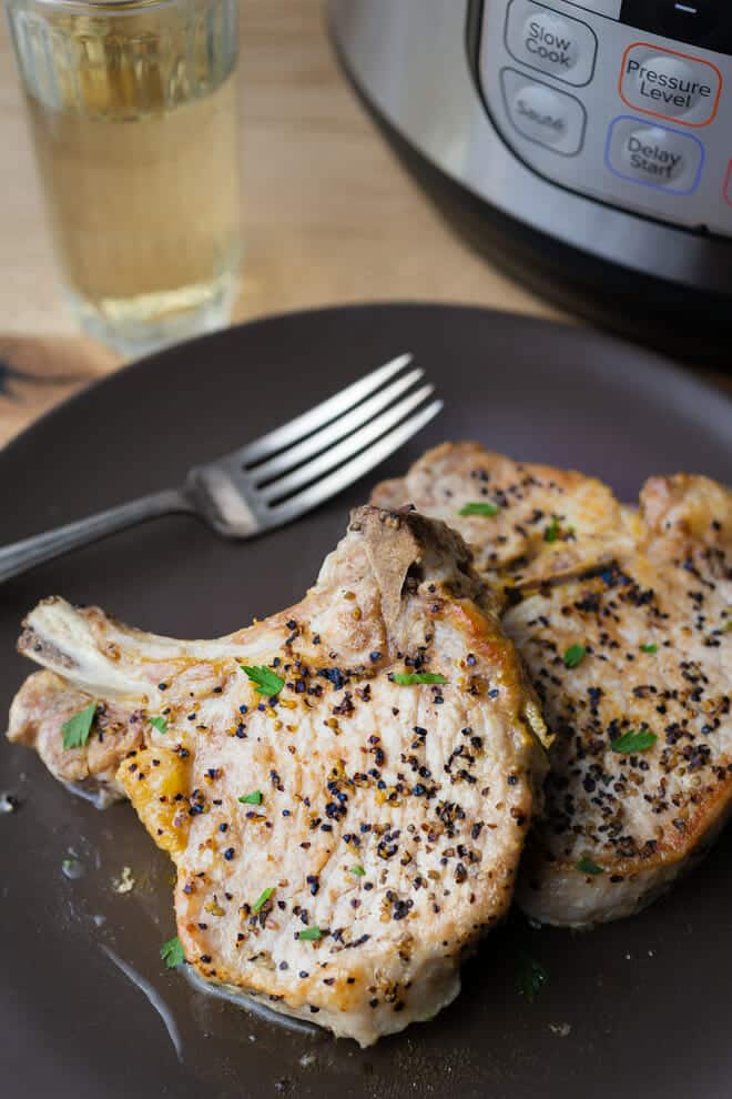 These Instant Pot pork chops are quick and easy to make.  They are simply seasoned with salt and pepper and are super delicious with a sprinkling of parsley or with your favorite sauce.