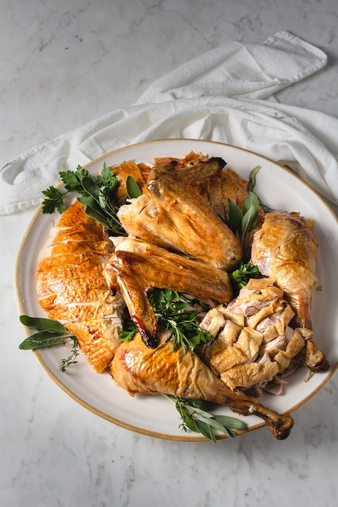 I love the idea of a whole roast turkey sitting elegantly on the holiday table, but a nicely arranged platter of sliced portions is equally as lovely and so much easier to serve.