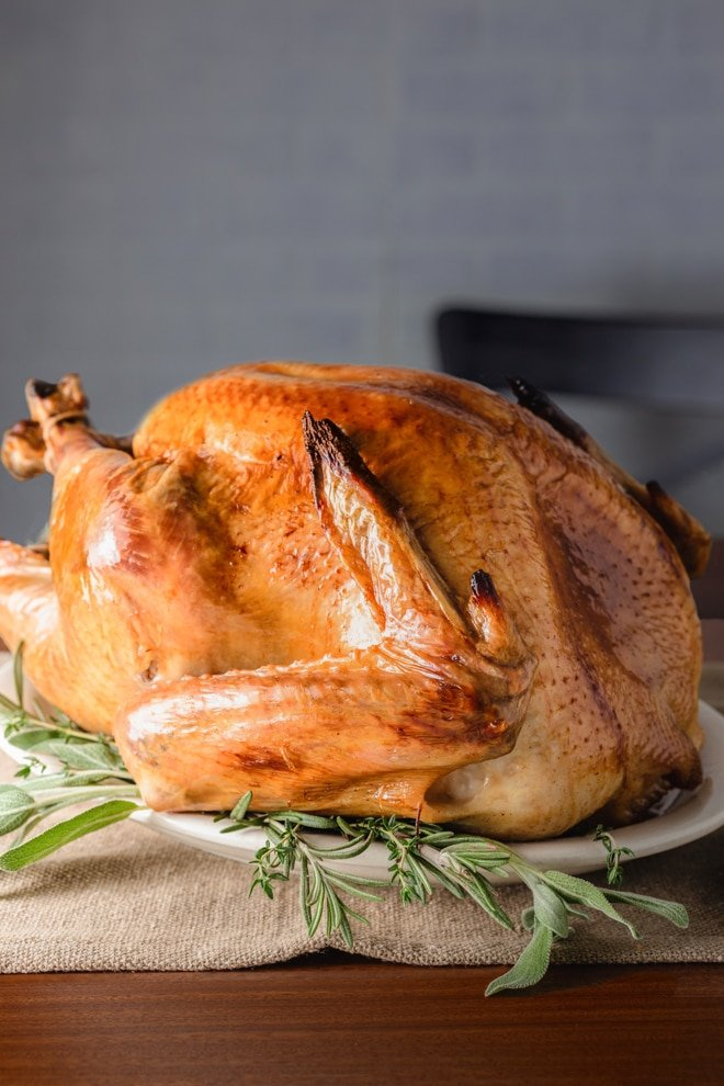 Roasting the perfect holiday turkey is a cinch.  You just need to know a couple of steps that I happily share in this post so it comes out juicy and flavorful.