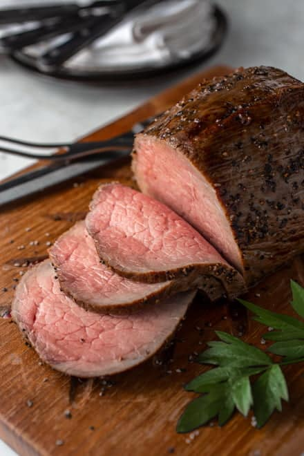 Serving a juicy, tender roast beef dinner doesn't have to break the bank. With a couple of simple methods, an economical cut of beef can be turned into roast fit for a holiday meal.