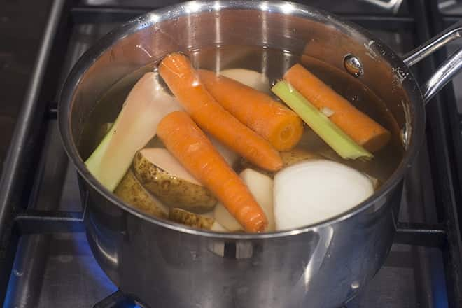 Water added to pot of veggies.
