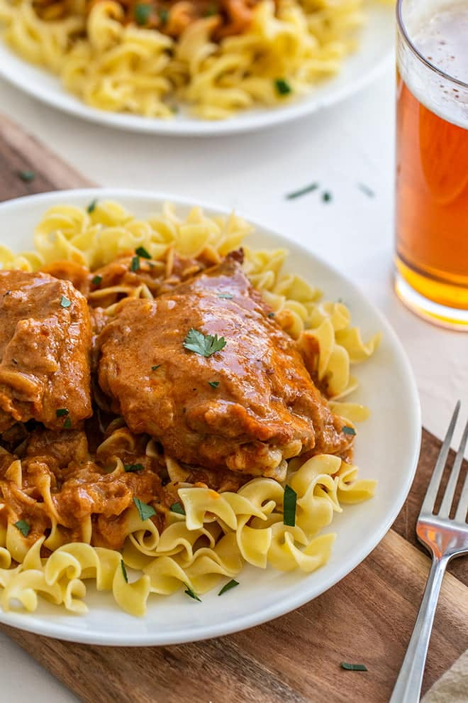 Chicken Paprikash is a traditional Hungarian dish that braises bone-in chicken in a paprika sauce and is traditionally served over egg noodles or dumplings.