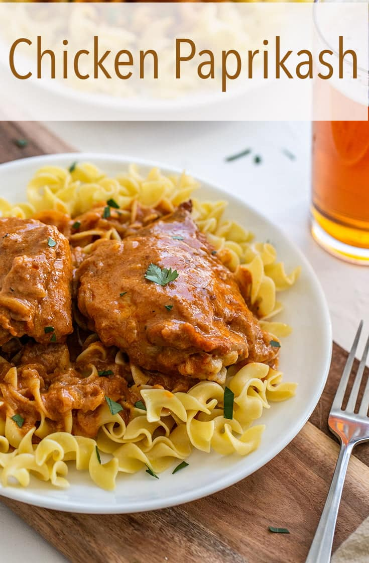 Looking for a new dinner idea? Chicken Paprikash is a traditional Hungarian dish that braises bone-in chicken in a paprika sauce and is traditionally served over egg noodles or dumplings. #chicken #chickendinner #hungarian
