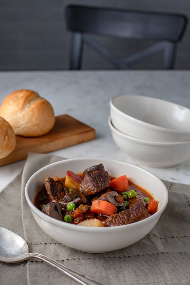 The word stew conjures up visions of friends and family gathered around the table on a chilly day enjoying each other's company as they dip into bowls of thick broth with chunks of meat and vegetables cooked to perfection.