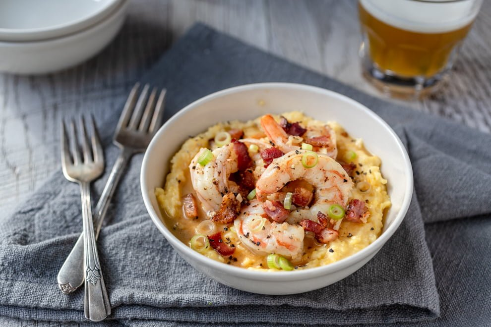 Shrimp and Grits may be a Southern dish, but y'all should know how to make it. Succulent shrimp top perfectly cooked and creamy grits.