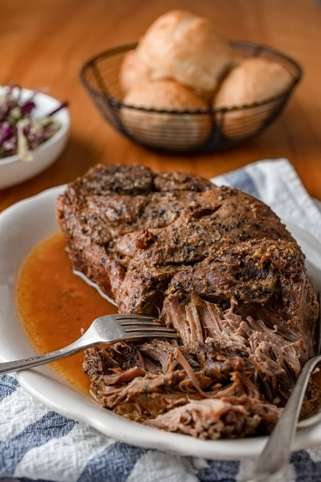 Low and slow. It truly is the secret to the best pulled pork. This slow cooker pulled pork recipe requires a little planning, but the results are so worth it!