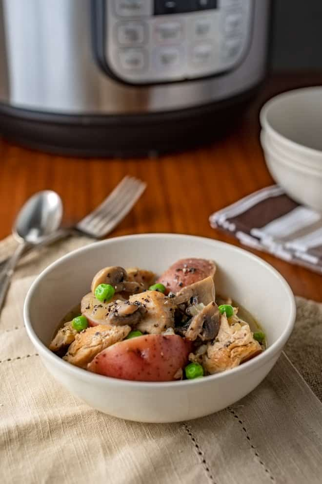 This Instant Pot Chicken Dinner with braised potatoes has everything you need for a satisfying meal served in one bowl. What more could a busy parent ask for?