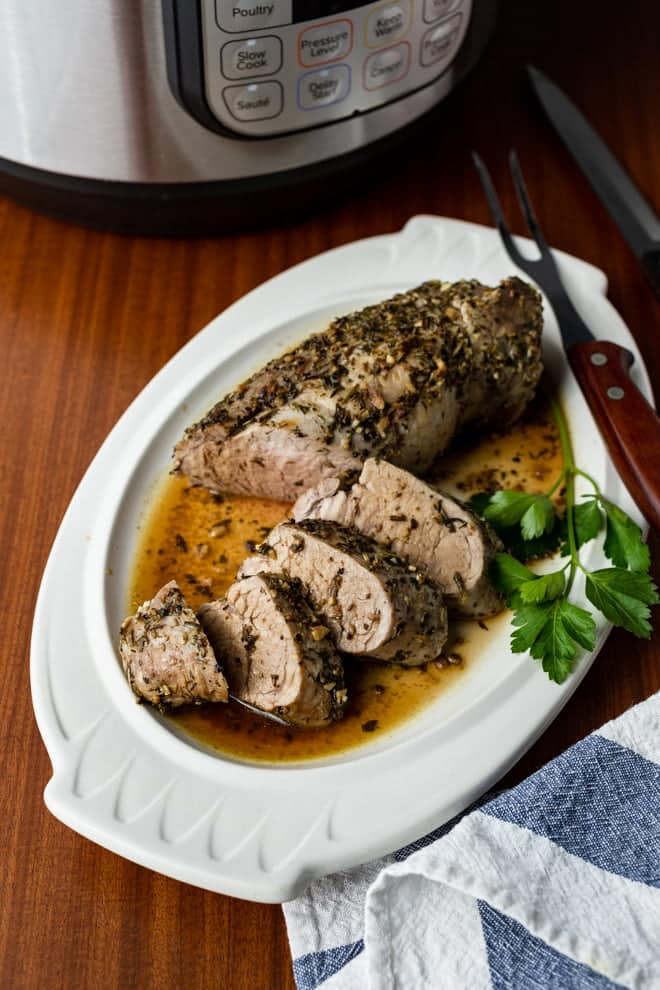 A garlicky herb rub adds the perfect balance of flavor to this easy Instant Pot recipe for the juiciest Pork Tenderloin you'll ever serve.