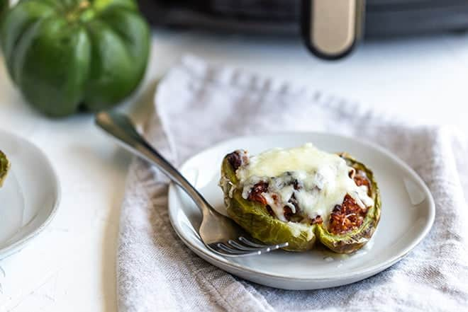 Bell pepper stuffed with beef and rice and topped with melted cheese.