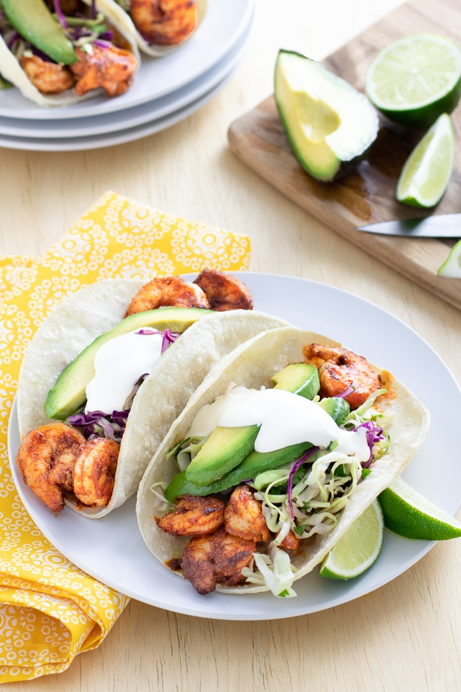 Succulent spice-rubbed shrimp. Bright flavorful slaw. Avocado and sour cream. All tucked into tender tortillas. One bite and you'll agree—these shrimp tacos are the BEST!