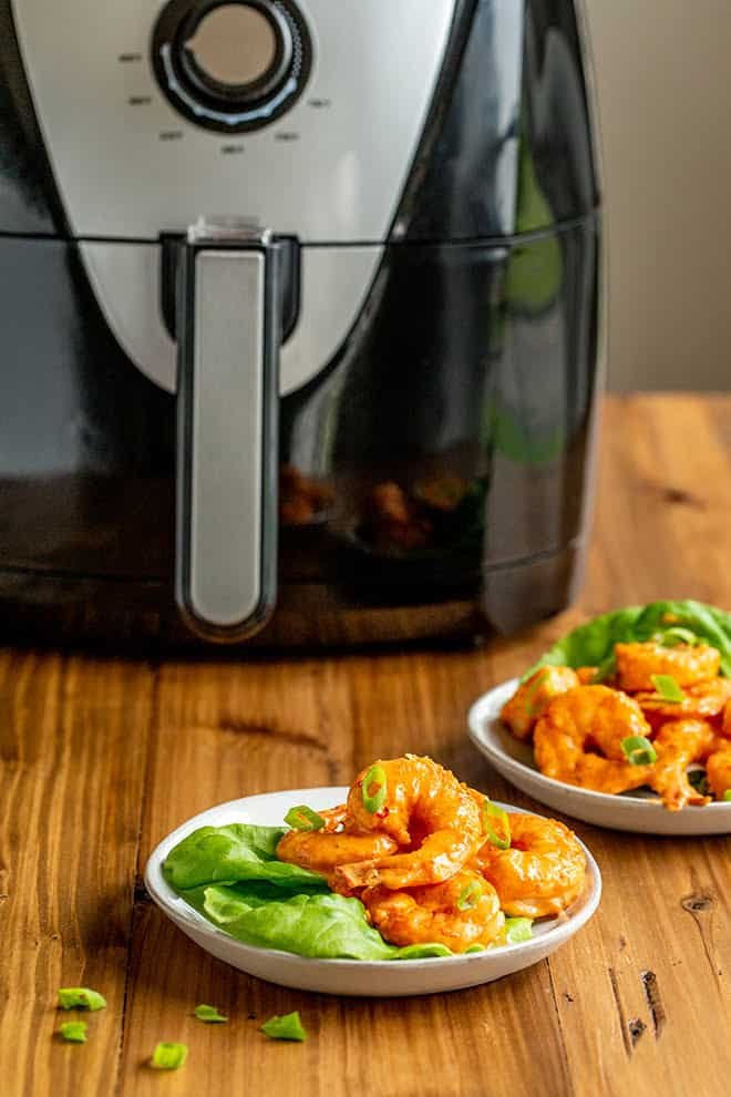 This Air Fryer Bang Bang Shrimp recipe lightens up traditional Bang bang Shrimp because you don't have to fry anything...but you still get the delicious, creamy sauce.