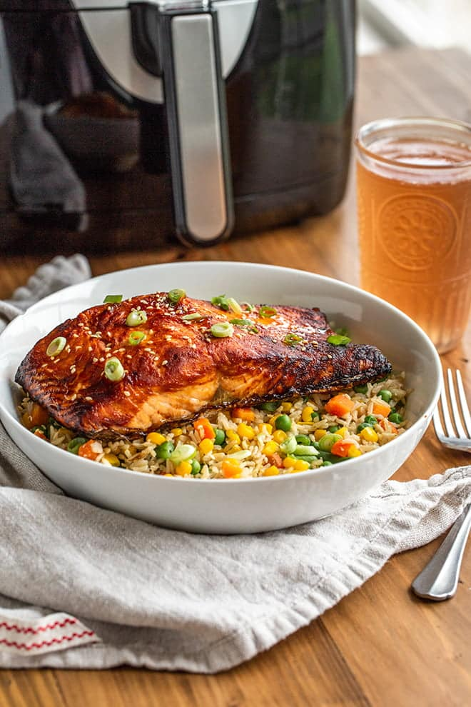 This air fryer sriracha salmon is spicy and juicy and it sits on top of crispy fried rice. The whole meal comes together in less than 30 minutes.