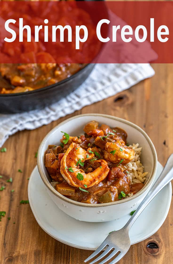 Shrimp Creole is a traditional Cajun dish that covers rice with shrimp cooked in a tomato based sauce with plenty of spices, onions, celery, and bell peppers.