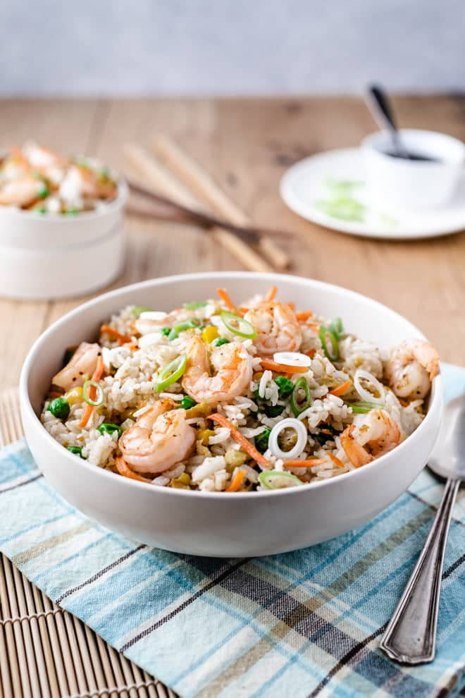 This Shrimp Fried Rice recipe loaded with juicy shrimp and colorful vegetables is so easy and delicious you won't want to call for take-out again.