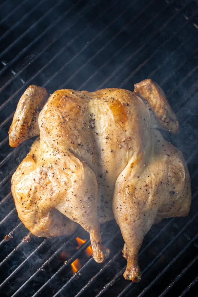 Spatchcocking or butterflying a chicken before grilling helps it to cook evenly creating a juicy, perfectly done chicken. The presentation is pretty impressive too.