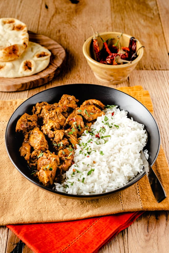 This easy Chicken Vindaloo, inspired by one of my favorite local Indian restaurants, takes advantage of pre-made garam masala and spices from the pantry. Making it an easy weeknight treat.