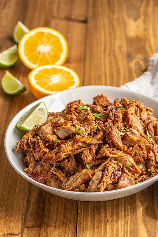 Making Pork Loin Carnitas is a great way to use up a pork loin. The leaner cut of meat gets fall-apart tender in a spicy and savory braising liquid.
