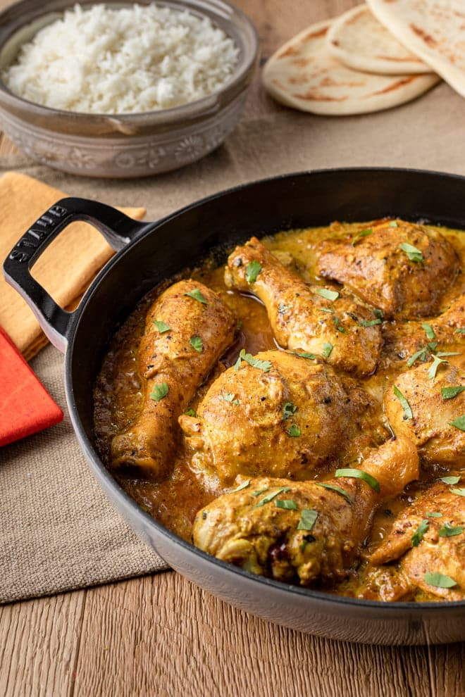 Yogurt-marinated chicken gently simmered in a fragrant, creamy sauce flavored with garam masla makes this Chicken Korma recipe virtually irresistible. #chicken #chickendinner #chickenskillet