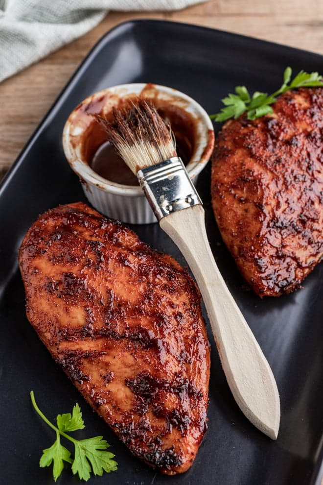 These BBQ Chicken Breasts grilled to tender perfection are basted toward the end with a basic BBQ sauce creating a savory-sweet, caramelized layer.