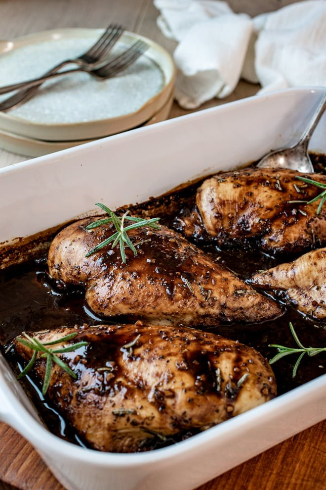 Balsamic vinegar, honey, brown sugar, and herbs create a sweet, tangy, irresistible sauce for this baked Balsamic Chicken Breast recipe.