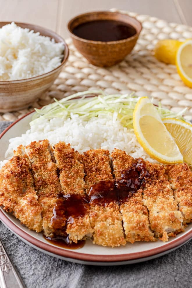Juicy, tender pork cutlets wrapped in a crispy layer of breadcrumbs with a sweet-and-savory sauce drizzled over the top makes this Air Fryer Pork Katsu an easy dish to fall in love with.