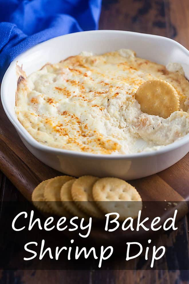 Cheesy, creamy, hot, and delicious! This Cheesy Baked Shrimp Dip is sure to become a new favorite for all your holidays and gatherings. #appetizer #dip #shrimp #cheese