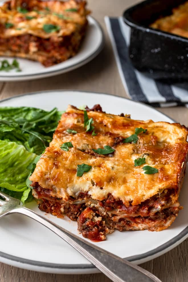 This No-Boil Lasagna recipe layered with a hearty meat sauce, seasoned ricotta, and gooey cheese uses regular lasagna noodles.