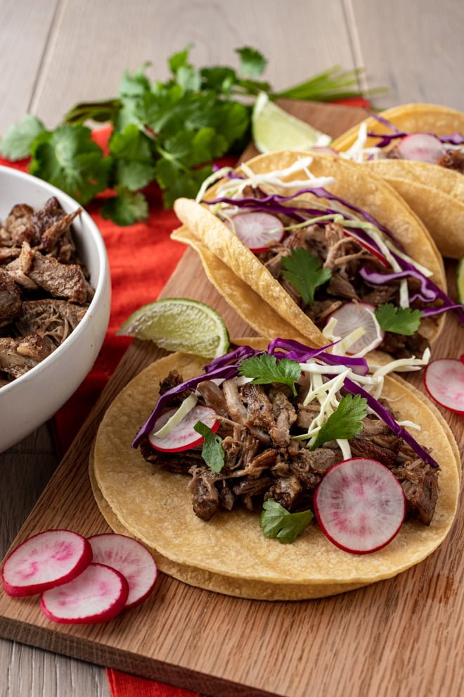 This easy Instant Pot Pork Carnitas recipe turns a pork shoulder into tender, juicy shredded pork perfect for creating delicious street-style tacos.
