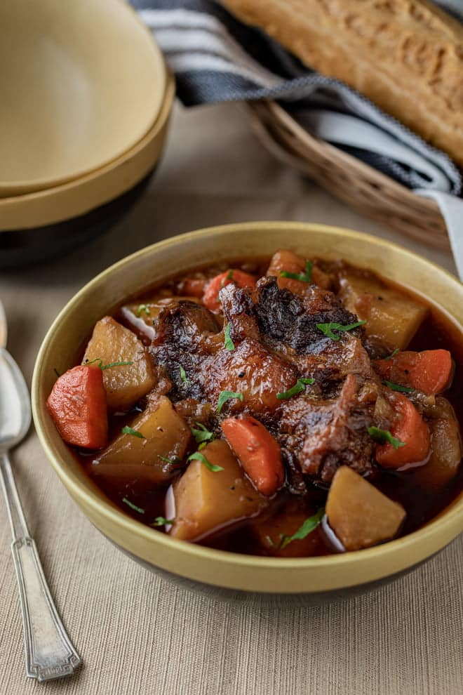 Though a humble cut, oxtail segments braised in a rich broth with root vegetables makes a sumptuous, comforting soup.