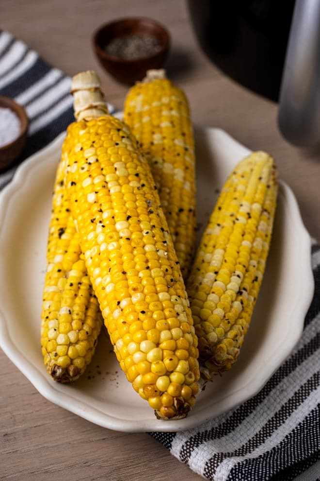 Use your air fryer to roast sweet corn on the cob in minutes! Eat it straight off the cob or use the roasted kernels to make your favorite corn dishes.
