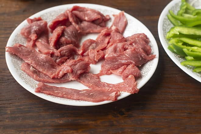 Thin slices of beef on a plate.