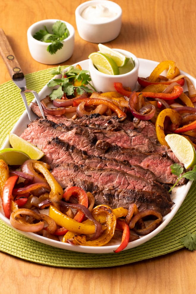 Love fajitas? Make 'em on the grill! My Grilled Steak Fajita Dinner cooks everything at once and gives restaurant fajitas a run for their money!