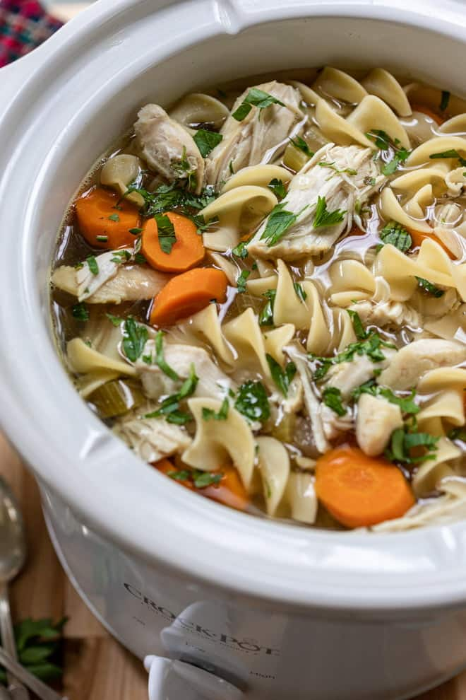 Comfort food at its best. This recipe for Slow Cooker Chicken Noodle Soup is brimming with veggies and simmered slowly throughout the day to create the perfectly chicken-y, chicken noodle soup.