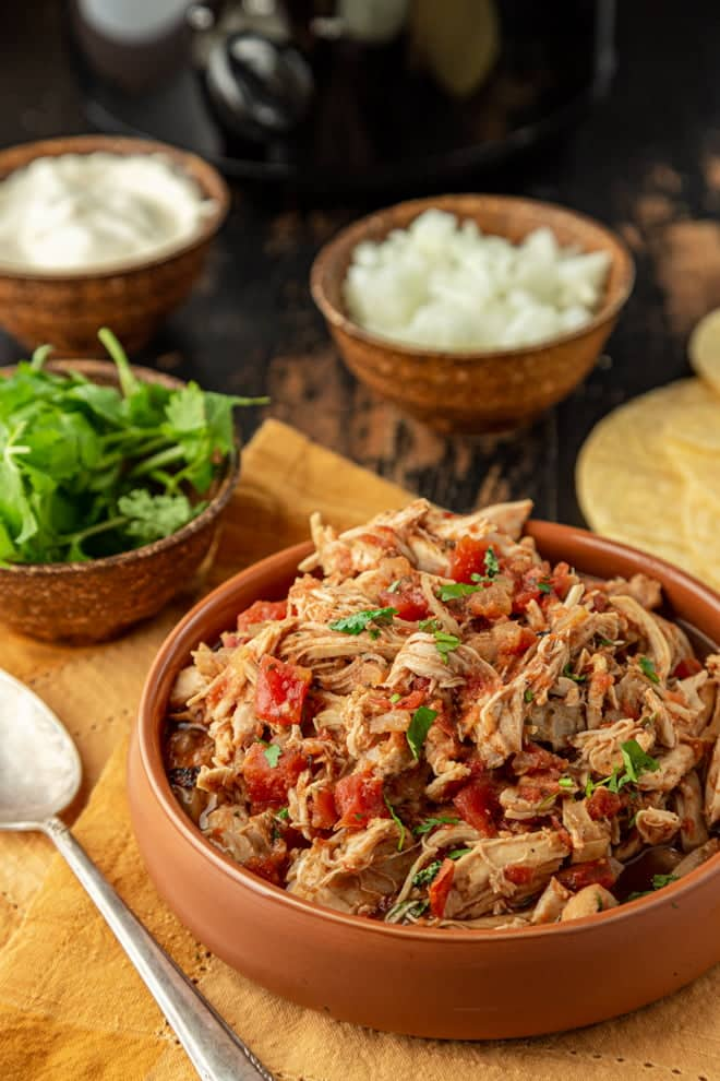 Taco night just got easier - and even more delicious! This zesty Slow Cooker Chicken Taco recipe is prepped in 10 minutes and then the slow cooker works its magic.