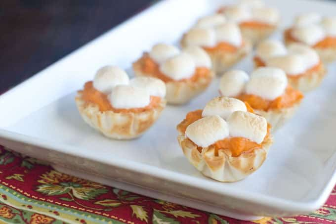 Phyllo cups with mashed sweet potato topped with marshmallows.