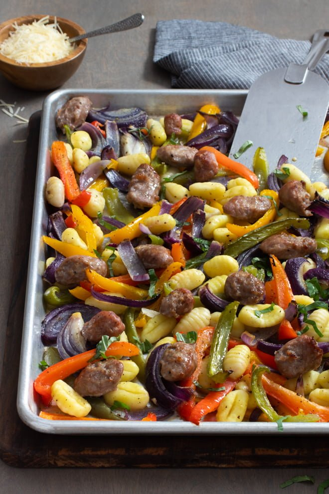 Store-bought gnocchi, Italian sausage, and veggies make a quick, easy, delicious dinner—and it all happens on a sheet pan! Just toss, roast, and enjoy!