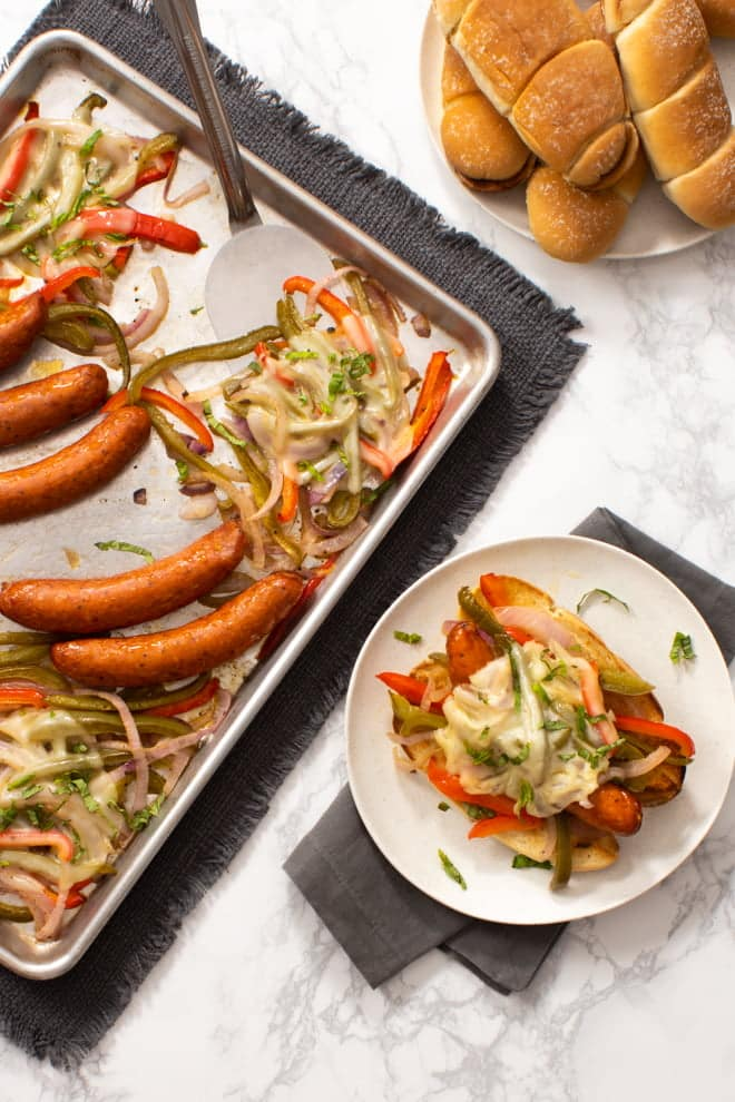 Meaty, cheesy, and easy! One the world's best sandwiches, a Sausage and Pepper Hoagie, is better than ever—because it all cooks together on one sheet pan!