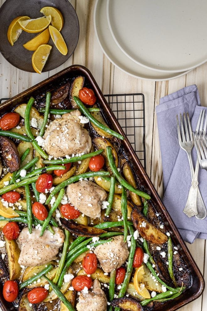 This Sheet Pan Greek Chicken and Potato Dinner, inspired by lemony Greek Potatoes, is sure to become a family favorite.
