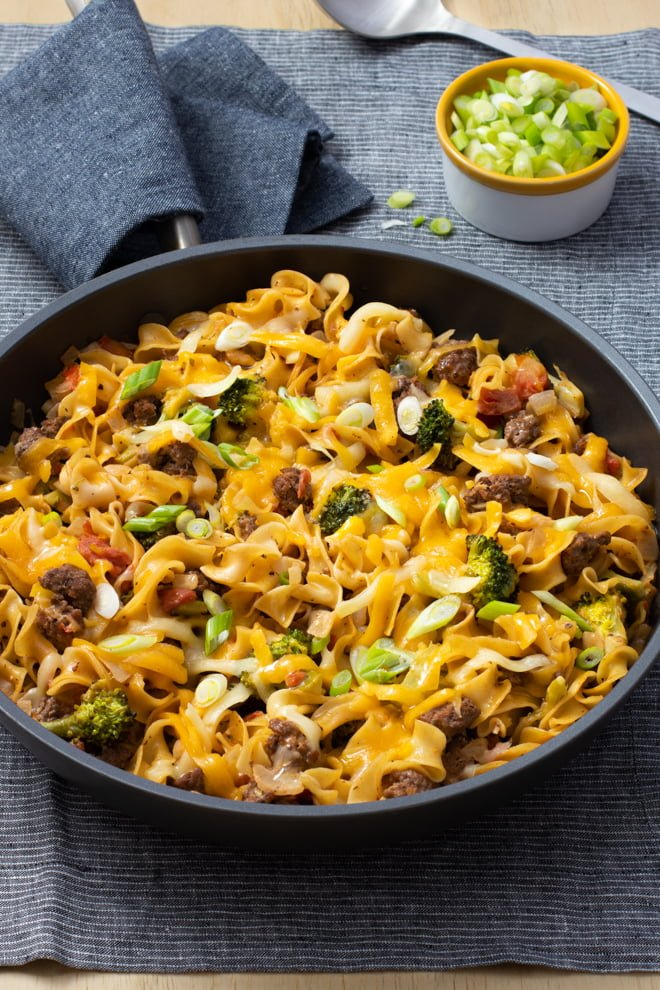 Beef noodle skillet with broccoli and cheddar cheese.